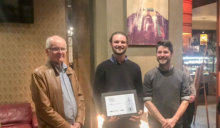 William Chrisp (middle) was awarded the scholarship at an NZILA event in Wellington. Bill Vincent (left) from Megabits made the presentation. NZILA Wellington Branch Chair Brennan Baxley is on the right.
