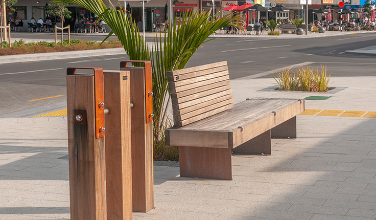 Street furniture uses a palette of Corten steel and Tonka hardwood, both materials used regularly in marine environments