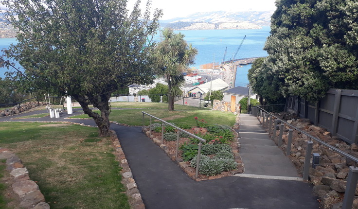 The grounds provide a peaceful vantage point overlooking the harbour.