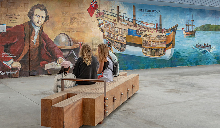 Whitianga Art group member, Peter Nicholson, created this mural on the wall of the Mainly Casual building immediately next to the new Whitianga town plaza in Albert Street. It depicts the Endeavour ship and botanist Joseph Banks (a member of the Endeavour's crew)