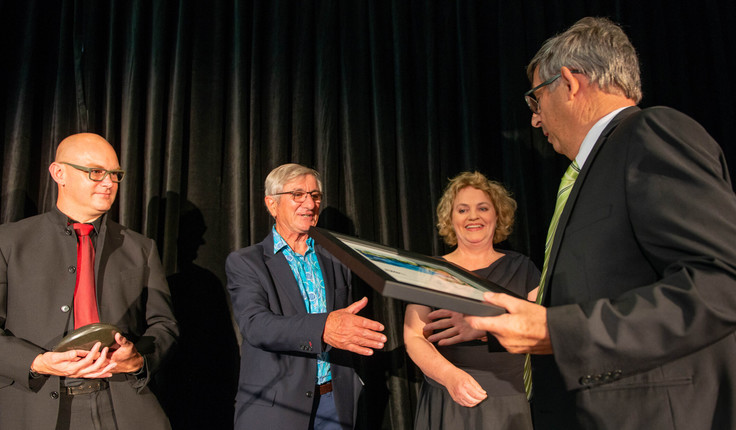 Chris Glasson receives his award from (L-R) NZILA President Brad Coombs, Frank Boffa and Dr Jacky Bowring last Friday night in Christchurch.