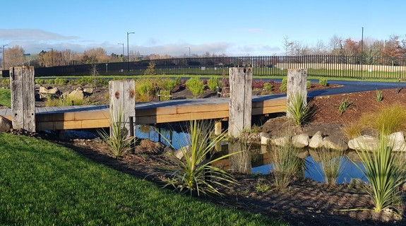 Timber bridges allow contact with the water, and good circulation for cyclists or joggers. The bridges are flanked by historic salvaged wharf beams, sourced from Lyttelton Port