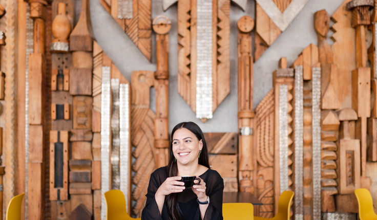 Image: uploads/2020_10/Smiling_girl_holding_a_cup_of_coffee_in_Box_Cafe_in_Auckland_with_wooden_2HVesKc.jpg