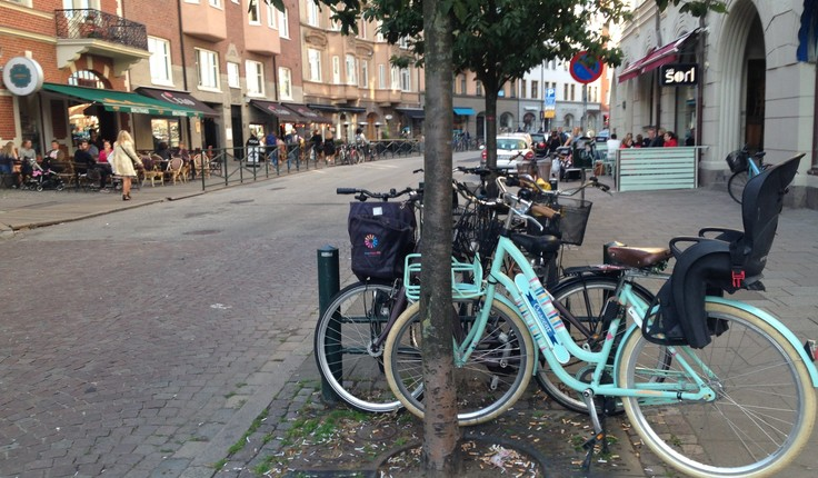 Locals using the shared street berm for cycle parking in Malmo, Sweden